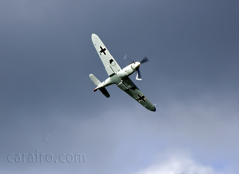The Buchon underside caught in the sunlight with a dark sky behind