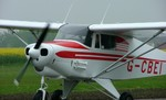 Piper PA22 comes in to park