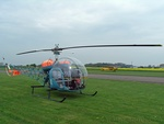 Bell 47 with Piper Super Cub in the background