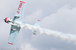 Yak 52 with smoke trail