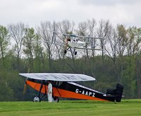 1928 DH60X landing with 1931 Desoutter I waiting