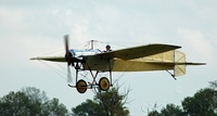 The pilot brings the monoplane in for a smooth landing