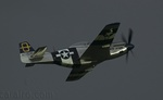 "P-51 Mustang ""Jumpin' Jacques"" with dark sky"