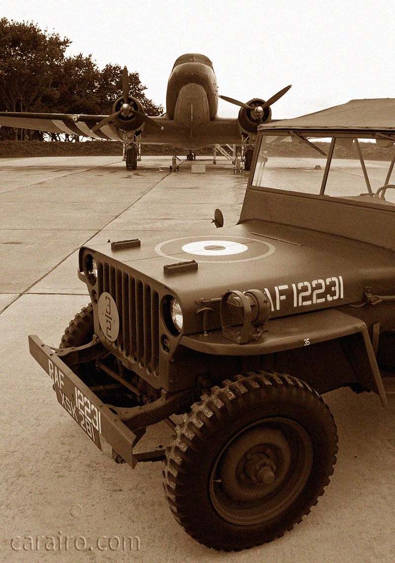 Jeep with RAF markings and Dakota in the background