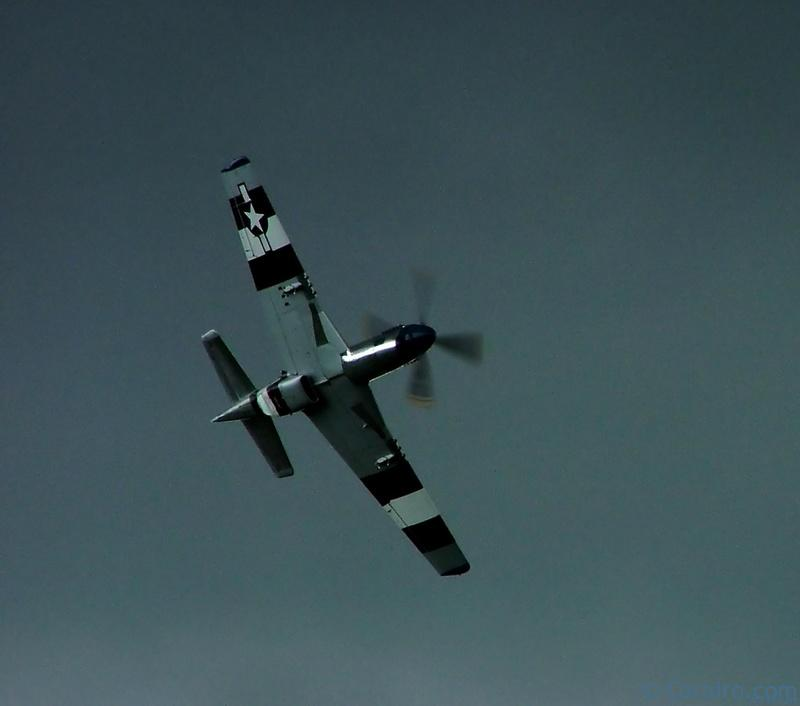 "P-51D Mustang ""Jumpin' Jacques"" climbs into a rapidly darkening sky"