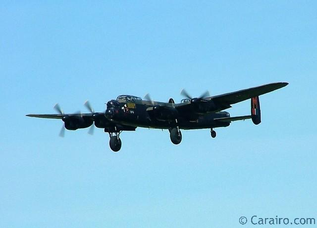 Battle of Britain Memorial Flight Lancaster performs a flypast with undercarriage down