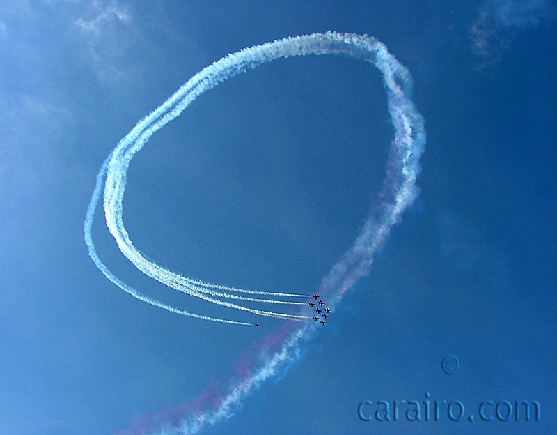 The Red Arrows perform a loop in the perfect blue sky