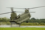 Chinook runs along the runway with rear wheels in contact